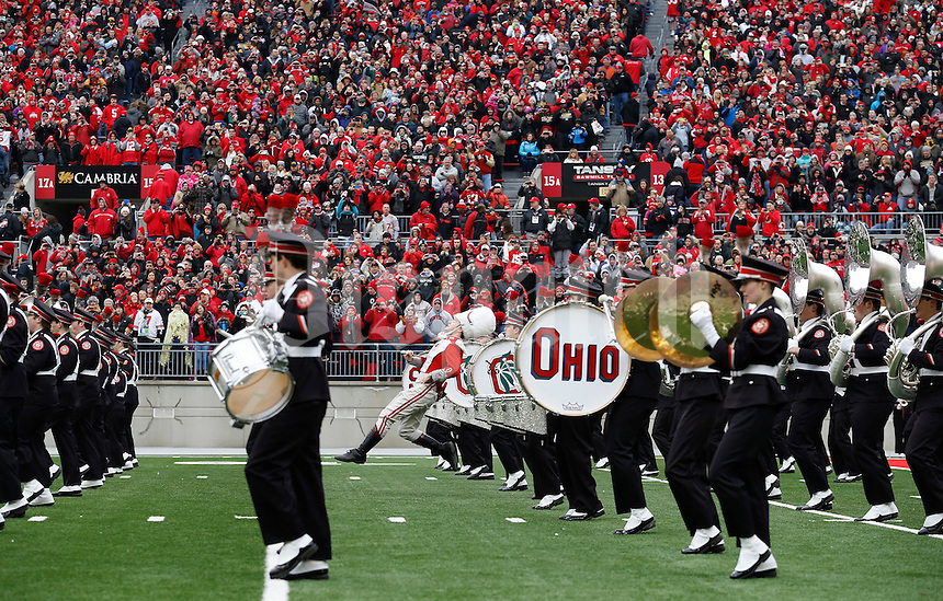 The Ohio State Marching Band performs on the field during the celebration for winning the national championship at Ohio Stadium on Jan. 24, 2015. (Adam Cairns / The Columbus Dispatch)