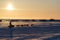 Matt Failor runs on the trail heading toward the finish at Nome during sunset on Wednesday March 14th during the 2018 Iditarod Sled Dog Race.  <br /> <br /> Photo by Jeff Schultz/SchultzPhoto.com  (C) 2018  ALL RIGHTS RESERVED
