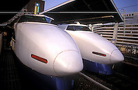 "Shinkansen's ""bullet trains"" in Tokyo, Japan. The Bullet train could be thought of as the world's first speed train. Services started in 1964 with speeds at 210km/h or 131mph, the fastest trains went at the time, and many countries stills have no trains running at this speed."