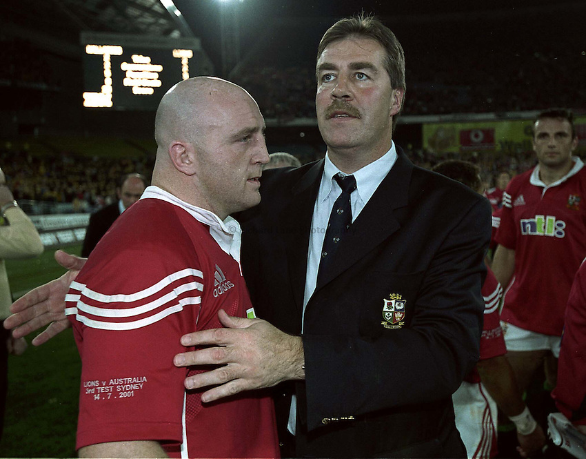 Photo. Richard Lane. .Lions Tour 2001 to Australia. Third Test at the Stadium Australia, Sydney, Australia. 14/7/2001.Keith Wood is consoled by Donal Lenahan.
