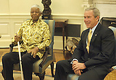 Washington, D.C. - May 17, 2005 -- United States President George W. Bush (R) meets with former President of South Africa, Nelson Mandela, in the Oval Office of the White House May 17, 2005 in Washington, DC. Mandela is on an official visit to the U.S., seeking support for the Nelson Mandela Legacy Trust which supports African-based charities. .Credit: Mannie Garcia - Pool via CNP