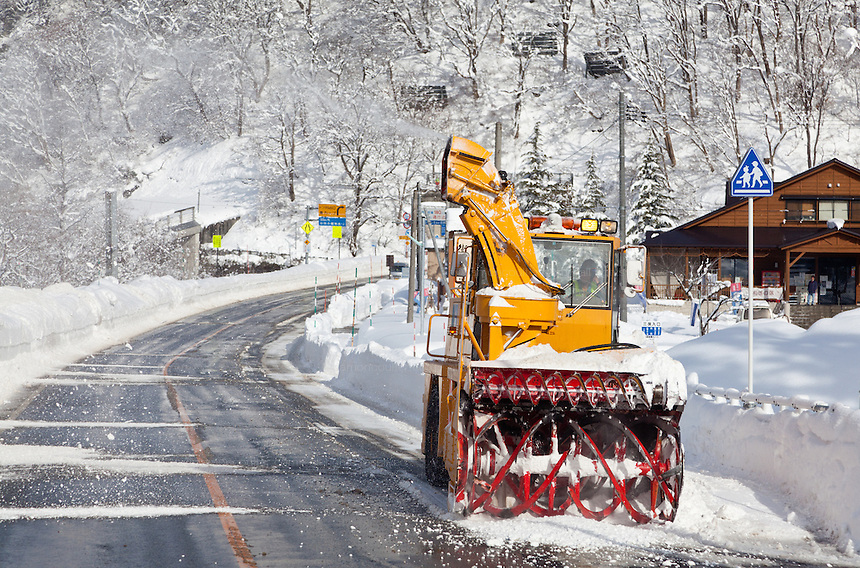 Snowploughs clearing heavy snow from roads in rural Niigata. Japan Saturday January 5th 2013