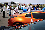 ACCRA, GHANA APRIL 19: Affluent men meet and show off their fancy sport cars at a shopping mall parking on April 19, 2015 in Accra, Ghana. Many young unemployed men here are involved in Romance scams, credit card fraud and etc. The country is a center for different online scams. Both men and women are lured to send cash to someone they only met on the net.  Due to limited opportunities, many youngsters spend their days in Internet cafes trying to scam people form all over the world. (Photo by: Per-Anders Pettersson)