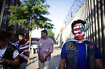 (L-R) Tenzin Dolkar, Tenzin Norsang, Hussein Khalique, and Tenzin Norgay walk around DUMBO during halftime of a screening of the US-Portugal World Cup game under the Manhattan Bridge archway in Brooklyn on June 22, 2014. The game ended 2-2 in overtime.