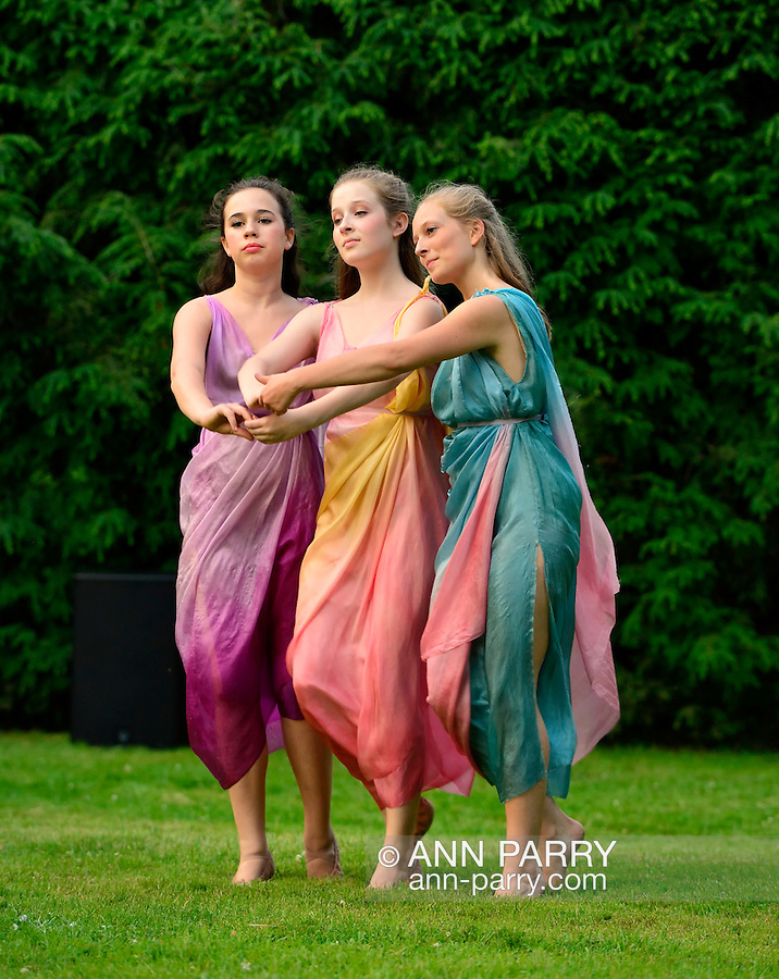 Old Westbury, New York, U.S. 22nd June 2013. Dancers in Lori Belilove &amp; The Isadora Duncan Dance Company, perform a dance of the Three Graces, at the Midsummer Night event at Old Westbury Gardens, throughout the illuminated grounds of the historic Long Island Gold Coast estate.<br />