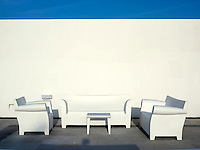 Mexico, Quintana Roo, Yucatan Peninsula, Akumal Mayan Riviera, white chairs against a white wall and blue sky