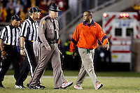 TALLAHASSEE, FL 11/19/11-FSU-UVA111911 CH-Virginia head Coach Mike London walks back to the bench as officials tell him there will be one more play during second half action Saturday at Doak Campbell Stadium in Tallahassee. The Seminoles lost to the Cavaliers 14-13..COLIN HACKLEY PHOTO