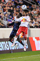 Dane Richards (19) of the New York Red Bulls and Kenny Mansally (7) of the New England Revolution go up for a header during a Major League Soccer (MLS) match at Red Bull Arena in Harrison, NJ, on October 21, 2010.