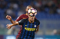Calcio, Serie A: Roma vs Inter. Roma, stadio Olimpico, 2 ottobre 2016.<br /> Roma&rsquo;s Bruno Peres, left, and FC Inter&rsquo;s Stevan Jovetic fight for the ball during the Italian Serie A football match between Roma and FC Inter at Rome's Olympic stadium, 2 October 2016.<br /> UPDATE IMAGES PRESS/Isabella Bonotto