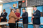 NAUGATUCK, CT. 08 December 2018-120818 - Chaplain Bill Detlefsen, second from right, presents Lydia LeBlanc with a commemorative lapel pin as Sergeant of Arms Ron Fischer, right, Naugatuck Deputy Mayor Laurie Tad-Jackson, center, and Frank Edmonds Jr, left look on during the honoring of Vietnam Veterans Spouses, part of the the Certificate of Honor Program at the American Legion Post 17 in Naugatuck on Saturday. This is the first time in Connecticut that any type of honor has been given to the spouses. Bill Shettle Republican-American
