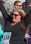 Becky James celebrates after the Run with the Girls event at Damonte Ranch High School on Sunday, Nov. 5, 2017.