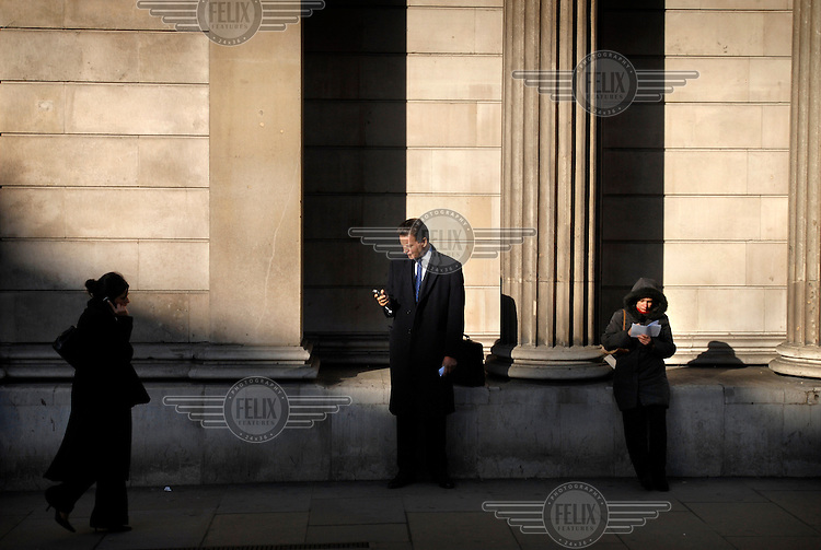 A businessman on his mobile telephone in the City.