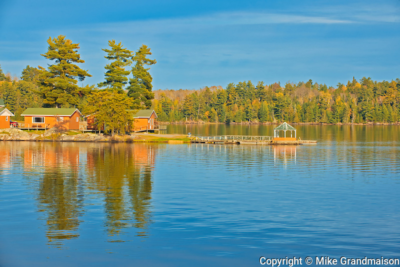Cottages reflected in Lake of the Woods<br />Sioux Narrows<br />Ontario<br />Canada