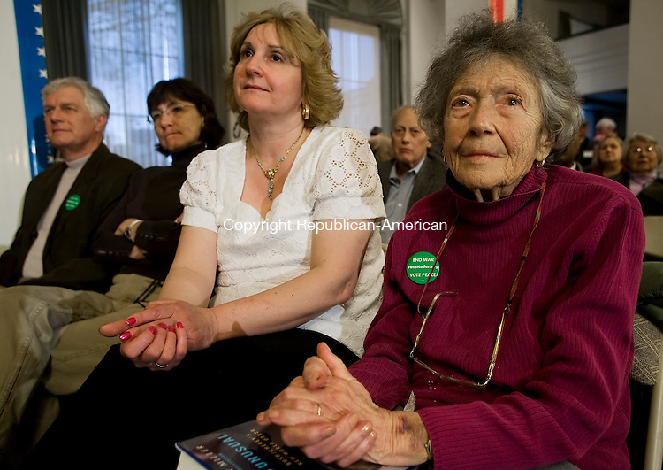 WATERBURY--27 April 2008--042708TJ07 - Alice Ellner, 87, right, from Oxford, with her nurse's aide Selina Dawid, of Ansonia, listen as Independent Party presidential hopeful Ralph Nader speaks in Waterbury on Sunday, April 27, 2008. (T.J. Kirkpatrick/Republican-American)