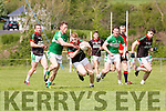 David Roche Milltown-Castlemaine is tackled by Jonathan Lyne Legion during their SFC clash in Killorglin on Sunday