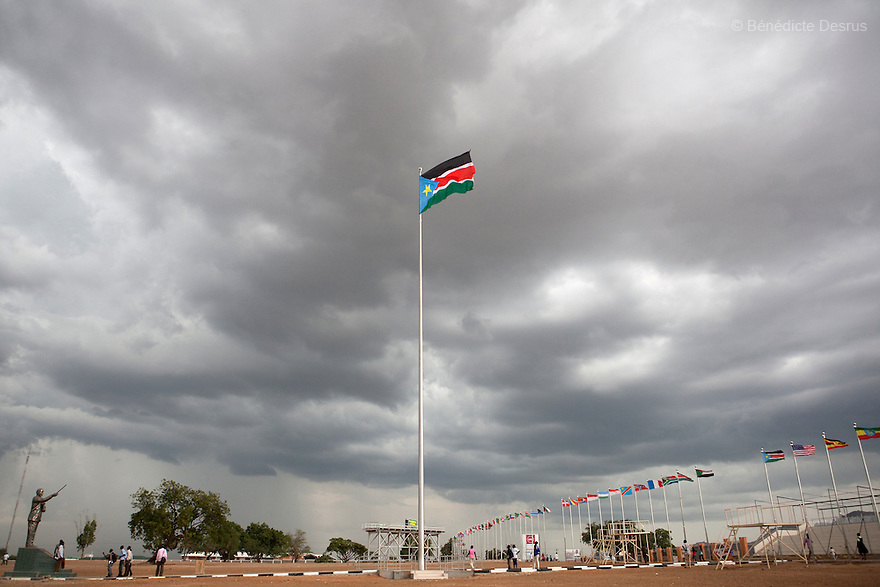 july 19, 2011 - Juba, Republic of South Sudan - The flag of the Republic of South Sudan and the newly constructed statue commemorating the late Dr. John Garang de Mabior, the leader of the Sudan People's Liberation Army at the Dr John Garang Mausoleum in the capital city of Juba. The statue was constructed ahead of southern Sudan's declaration of independence, which occurred on 9 july 2011. The Republic of South Sudan became a United Nations member state and the world's 193rd country. Photo credit: Benedicte Desrus