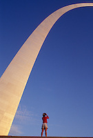 St. Louis, Gateway Arch, MO, Missouri, Woman looking up at the towering Gateway Arch in Saint Louis. Jefferson National Expansion Memorial. Gateway to the West.