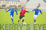St Brendan's Park's Tom McLoughlin and Killarney Celtic's l-r: Cian Leonaird and Shane O'Sullivan.