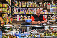 Vendor at the La Boqueria market located by the La Rambla, Barcelona, Spain