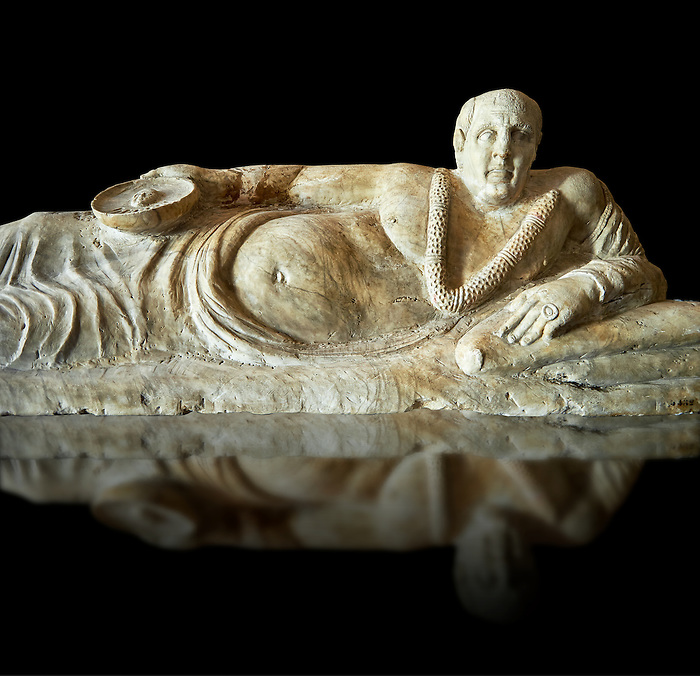 Close up of an Etruscan Hellenistic style cinerary, funreary, urn cover with a man,  National Archaeological Museum Florence, Italy , black background