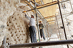 Workers is Bamiyan, Afghanistan, work to reinforce the inner wall of the eastern Buddha niche on May 26, 2011.  A large Buddha statue once stood there before the Taliban destroyed it in 2001.  Photo by Ted Richardson