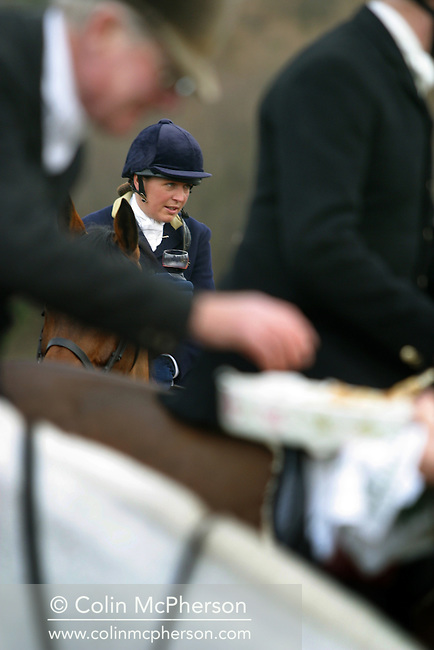 A woman member of the Wynnstay Hunt drinks a tradional glass of port before the hunt rides out for a day's foxhunting. The Wynnstay Hunt, named after Sir Watkin Williams-Wynn, dated back to the 18th century and hunted on country estates in Shropshire, Cheshire and north Wales. Hunting with dogs in England and Wales became illegal on 18th February 2005 despite legal challenges to the ban and many hunts vowed to continue the ancient sport of foxhunting, risking prosecution.