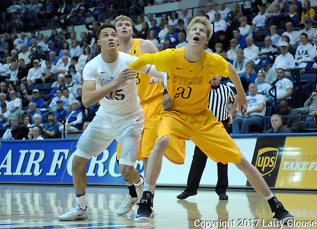 February 4, 2017:  Wyoming forward, Hayden Dalton #20, battles Falcon forward, Hayden Graham #35 for rebound position during the NCAA basketball game between the Wyoming Cowboys and the Air Force Academy Falcons, Clune Arena, U.S. Air Force Academy, Colorado Springs, Colorado.  Wyoming defeats Air Force 83-74.