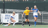 Allston, Massachusetts - August 1, 2015:  In a National Women's Soccer League (NWSL) match, Seattle Reign (white) defeated Boston Breakers (blue), 2-1, at Soldiers Field Soccer Stadium.<br /> <br /> Julie King foul results in penalty kick.