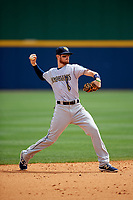 New Orleans Baby Cakes shortstop J.T. Riddle (10) throws to first base during a game against the Nashville Sounds on May 1, 2017 at First Tennessee Park in Nashville, Tennessee.  Nashville defeated New Orleans 6-4.  (Mike Janes/Four Seam Images)