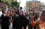 A Coptic Christian woman shouts slogans against Egyptian President Mohamed Mursi and members of the Brotherhood in front of the main Coptic cathedral in Cairo April 8, 2013. A second Egyptian died on Monday of wounds sustained in clashes at Cairo's Coptic cathedral the previous day in an outbreak of sectarian violence that the government and Muslim and Christian leaders sought to calm. Photo by Tareq Gabas