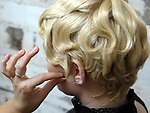 (Boston Ma 050313) Brittany Sybertz, with the nearly completed Gatsby hair style being worked on by stylist  Graziella Lembo, prior to that by stylist Shaun O'Connor  (Jim Michaud  Photo) Adv