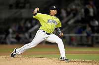 Closing pitcher Darwin Ramos (34) of the Columbia Fireflies delivers a pitch in a game against the Augusta GreenJackets on Friday, April 6, 2018, at Spirit Communications Park in Columbia, South Carolina. Columbia won, 7-2. (Tom Priddy/Four Seam Images)