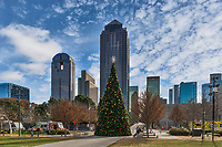 Christmas tree with the Dallas skyline behind on a nice December day in a downtown park. The Kylde Warren park was designed on the edge of the art district and an urban neighborhood. The park was built over the Woodall Rodger Freeway and it joins the downtown with the uptown area of town. The park is 5.2 acres and is three city blocks and is located right across from the Dallas Museum of Art, AT&T Performing Art Center, and the Nasher Sculpture Center and more in this downtown cityscape. The park has a dog park, a children play area, restaurants, performance pavilion along with hike and biking areas. Also on the day we were there were lots of food trucks.