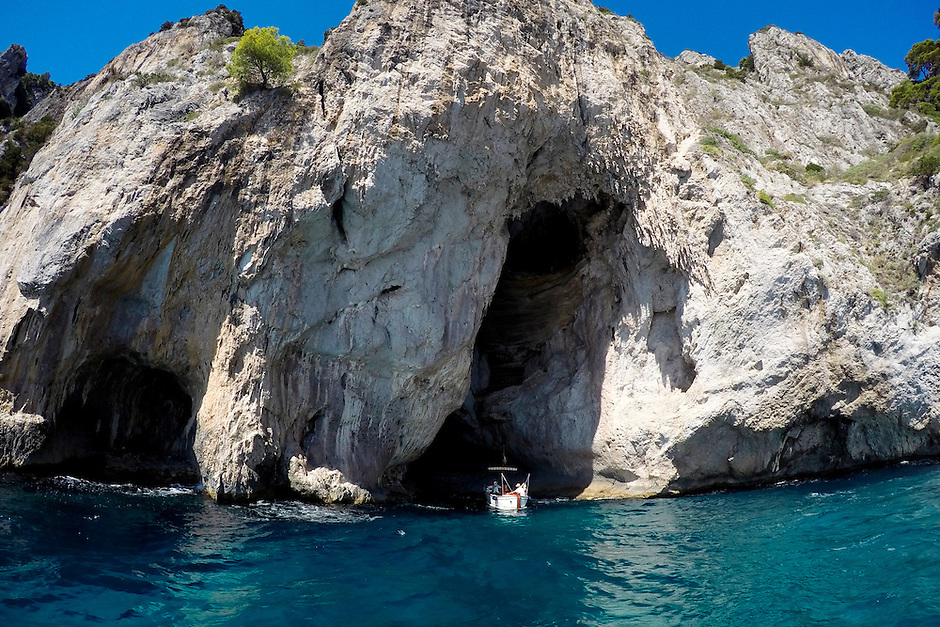 Boaters make their way into a cavern during a tour on Monday, Sept. 21, 2015, off the island of Capri in Italy. (Photo by James Brosher)