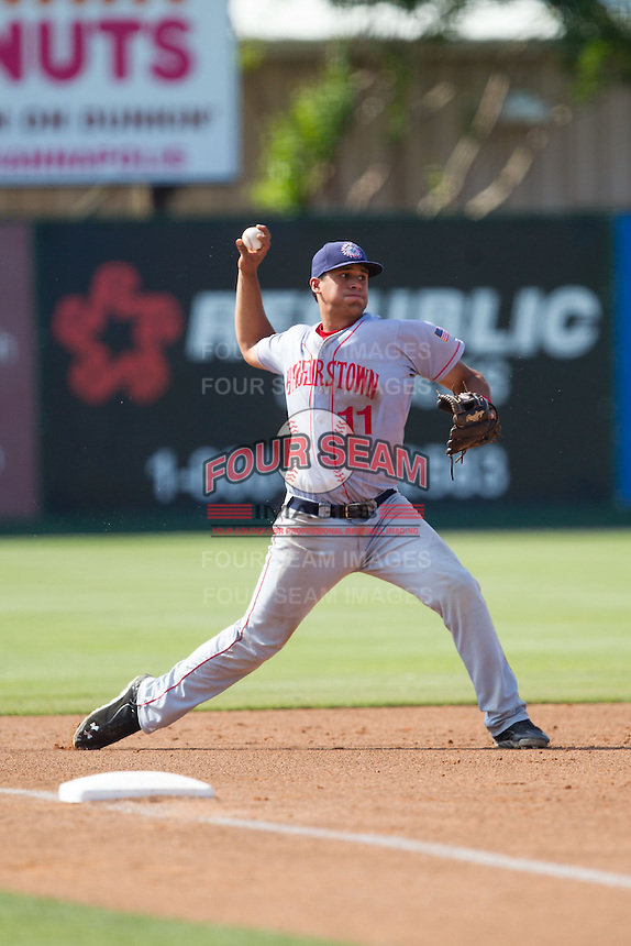 Hagerstown Suns third baseman Drew Ward (11) makes a throw to first base against the Kannapolis Intimidators at CMC-Northeast Stadium on June 1, 2014 in Kannapolis, North Carolina.  The Intimidators defeated the Suns 5-1 in game one of a double-header.  (Brian Westerholt/Four Seam Images)