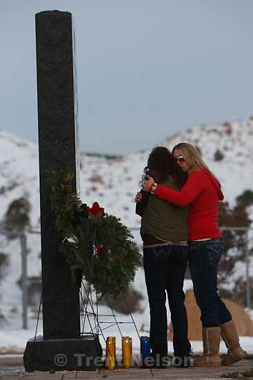 Janice Carter pays her respects at a memorial for the 27 people who died in the Wilberg Mine disaster 25 years ago today, Saturday, December 19, 2009. Carter's husband Curtis Carter perished in the disaster.