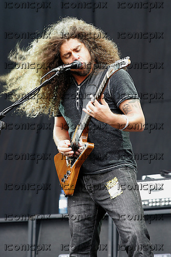 COHEED and CAMBRIA - vocalist guitarist Claudio Sanchez performing live on Day One on the Main Stage at the  Reading Festival 2012 at Richfield Avenue Reading UK - 24 Aug 2012.  Photo credit: Dean Fardell