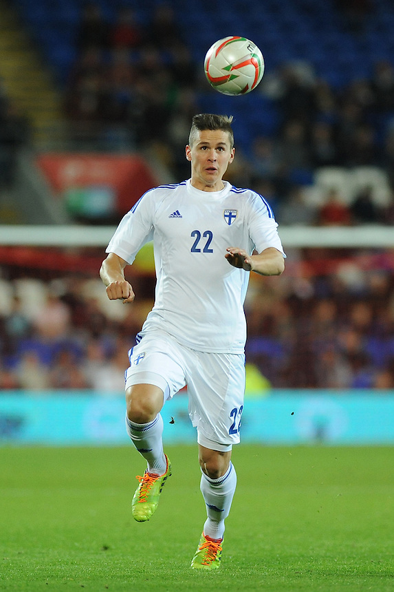 Finland's Jukka Raitala in action during todays match  <br /> <br /> Photo by Ashley Crowden/CameraSport<br /> <br /> Football - International Friendly - Wales v Finland - Saturday 16th November 2013 - Cardiff City Stadium - Cardiff<br /> <br /> &copy; CameraSport - 43 Linden Ave. Countesthorpe. Leicester. England. LE8 5PG - Tel: +44 (0) 116 277 4147 - admin@camerasport.com - www.camerasport.com