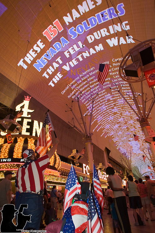 Tribute to fallen Nevada soldiers during Vietnam War with names projected on the Viva Vision .