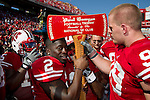 Wisconsin Badgers Jay Valai (2) and J.J. Watt (99) grab the Paul Bunyan Axe after defeating the Minnesota Golden Gophers after an NCAA college football game on October 9, 2010 at Camp Randall Stadium in Madison, Wisconsin. The Badgers beat the Golden Gophers 41-23. (Photo by David Stluka)