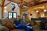 Steve and Jennifer Schatz in the main living area of their rural Pacific home. The open-concept home is designed to resemble a Missouri dairy barn and has exposed timbers throughout.<br /> Photo by Tim Vizer