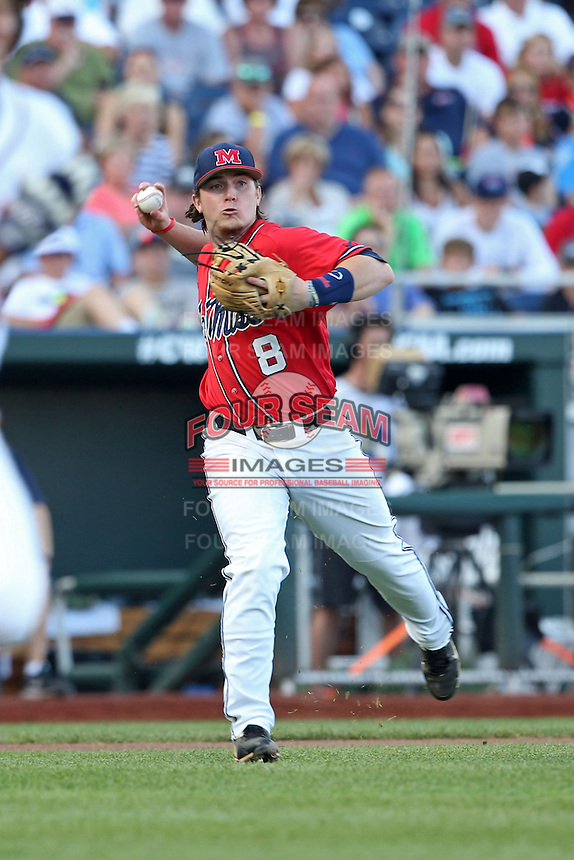 Austin Anderson #8 of the Ole Miss Rebels throws during Game 4 of the 2014 Men's College World Series between the Virginia Cavaliers and Ole Miss Rebels at TD Ameritrade Park on June 15, 2014 in Omaha, Nebraska. (Brace Hemmelgarn/Four Seam Images)