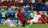 SARANSK - RUSIA, 25-06-2018: Vahid AMIRI y Omid EBRAHIMI (Der) jugadores de RI de Irán disputan el balón con WILLIAM (C) jugador de Portugal durante partido de la primera fase, Grupo B, por la Copa Mundial de la FIFA Rusia 2018 jugado en el estadio Mordovia Arena en Saransk, Rusia. / Vahid AMIRI (L) and Omid EBRAHIMI (R) players of IR Iran fight the ball with WILLIAM (C) player of Portugal during match of the first phase, Group B, for the FIFA World Cup Russia 2018 played at Mordovia Arena stadium in Saransk, Russia. Photo: VizzorImage / Julian Medina / Cont