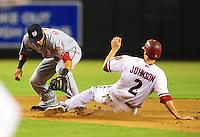 Aug. 3, 2010; Phoenix, AZ, USA; Washington Nationals shortstop Ian Desmond tags out Arizona Diamondbacks base runner (2) Kelly Johnson at Chase Field. Mandatory Credit: Mark J. Rebilas-.
