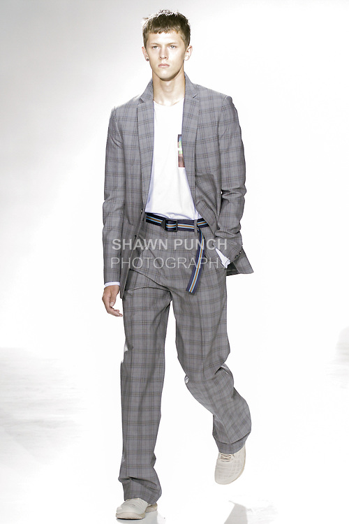 "Model walks runway in an outfit from the Richard Chai Mens Spring 2016 ""Pet Shop Boys"" collection runway show, during New York Fashion Week Men's Spring Summer 2016."
