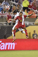 Orlando, FL - Monday June 06, 2016: Bolivia defender Diego Bejarano (4) and Panama midfielder Alberto Quintero (19) during a Copa America Centenario Group D match between Panama (PAN) and Bolivia (BOL) at Camping World Stadium.