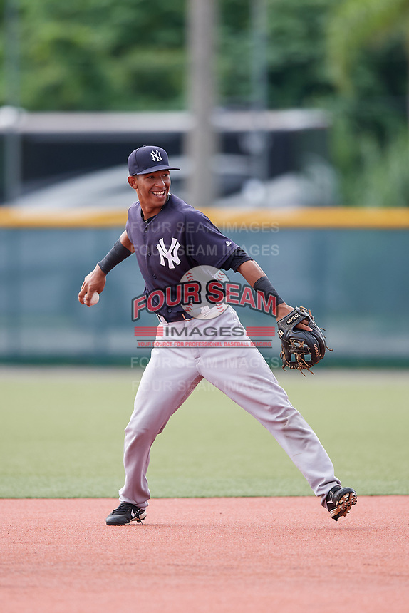 GCL Yankees East second baseman Asdrubal Alvarez (1) throws to first base during the first game of a doubleheader against the GCL Pirates on July 31, 2018 at Pirate City Complex in Bradenton, Florida.  GCL Yankees East defeated GCL Pirates 2-0.  (Mike Janes/Four Seam Images)