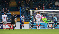 Josh Payne (4) of Crawley Town watches as his long distance free kick flies into the net during the Sky Bet League 2 match between Wycombe Wanderers and Crawley Town at Adams Park, High Wycombe, England on 25 February 2017. Photo by Andy Rowland / PRiME Media Images.