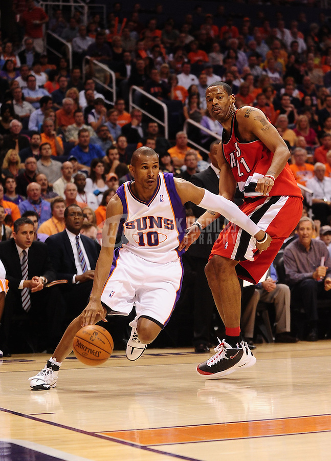 Apr. 20, 2010; Phoenix, AZ, USA; Phoenix Suns guard (10) Leandro Barbosa drives to the basket past Portland Trail Blazers forward Marcus Camby in game two in the first round of the 2010 NBA playoffs at the US Airways Center. Phoenix defeated Portland 119-90. Mandatory Credit: Mark J. Rebilas-