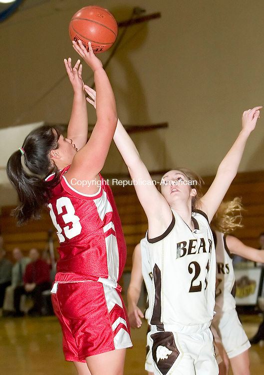 THOMASTON, CT- 05 DEC 2007- 120507JT05-<br /> Wamogo's Kim Layman attempts a shot over Thomaston's Stephanie Keith during Wednesday's game at Thomaston. Thomaston won 54-51.<br /> Josalee Thrift / Republican-American